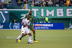 June 15, 2018 - Portland, Oregon, U.S. - PORTLAND, OR - JUNE 15: LA Galaxy midfielder Emmanuel Boateng controls a ball marked by Potland Timbers midfielder Lawrence Ollum during the Portland Timbers game versus the LA Galaxy in a United States Open Cup match on June 15, 2018, at Providence Park, OR. (Photo by Diego G Diaz/Icon Sportswire) (Credit Image: © Diego Diaz/Icon SMI via ZUMA Press)