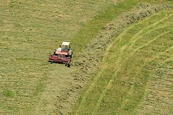 THEMENBILD - ein Landwirt mit Traktor und Maehwerk bei der Heuernte auf einem steilen Hang, aufgenommen am 11. August 2015, Maishofen, Österreich// a farmer with tractor mowing hay in a Field, Maishofen, Austria on 2015/08/11. EXPA Pictures © 2015, PhotoCredit: EXPA/ JFK