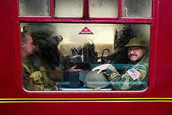 © Licensed to London News Pictures. <br /> 16/10/2016. <br /> Grosmont, UK.  <br /> <br /> Men wearing 1940's military clothing sit on board a steam locomotive at Grosmont station during the final day of the North Yorkshire Moors Railway Wartime Weekend event. <br /> The annual event brings together re-enactors and enthusiasts along the length of the NYMR heritage steam railway line to recreate the feel of the war years of the 1940's. <br /> <br /> Photo credit: Ian Forsyth/LNP