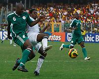 Photo: Steve Bond/Richard Lane Photography.<br />Ghana v Nigeria. Africa Cup of Nations. 03/02/2008. Daniel Shittu (L) gets the better of Asamoah Gyan (R)