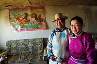 Mongolian Shepherd Ge Ri Li Ao De with his wife Ao Te Gen, at their home, Inner Mongolia, China