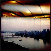 A view over the Taedong River and the capital of Pyongyang, North Korea. From the Yanggakdo Hotel.