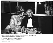 Randi White & Max Factor at the Beverly Hills Hotel re-Opening Party. Beverley Hills. Los Angeles. 1995. Film 95271/7<br /><br />© Copyright Photograph by Dafydd Jones<br />66 Stockwell Park Rd. London SW9 0DA<br />Tel 0171 733 0108