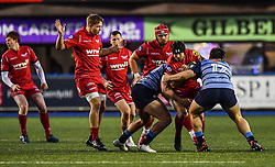 Scarlets' Leigh Halfpenny is tackled by Cardiff Blues' Bradley Thyer - Mandatory by-line: Craig Thomas/Replay images - 31/12/2017 - RUGBY - Cardiff Arms Park - Cardiff , Wales - Blues v Scarlets - Guinness Pro 14