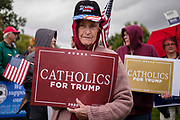 28 SEPTEMBER 2020 - JOHNSTON, IOWA: A member of Catholics for Trump rally with Senator Joni Ernst's supporters before the US Senate debate at the Iowa PBS studios in Johnston. Both US Senator Joni Ernst, the Republican incumbent, and Theresa Greenfield, the Democratic challenger, had rallies before the debate. Polling puts the race within the margin of error.       PHOTO BY JACK KURTZ