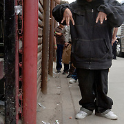 Undocumented migrants, including this alleged gang member, line up along the border fence for deportation back to Mexico after being caught entering the country illegally. Please contact Todd Bigelow directly with your licensing requests. PLEASE CONTACT TODD BIGELOW DIRECTLY WITH YOUR LICENSING REQUEST. THANK YOU!
