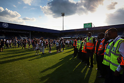 2 September 2017 - Charity Football - Game 4 Grenfell - Stewards form a ring around the tunnel as fans invade the pitch after full time - Photo: Charlotte Wilson