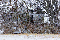 This dilapidated old house is ready to collapse.  It stands (for the time being) about 300 yards south of 700n on old Rt. 51 near Heyworth IL in McLean County.  Photograph was taken on a snowy day in February 2021.