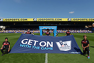 a Barclays 'GET ON WITH THE GAME' banner held up by Ball Boys before k/o. Barclays Premier league match, Crystal Palace v Aston Villa at Selhurst Park in London on Saturday 22nd August 2015.<br /> pic by John Patrick Fletcher, Andrew Orchard sports photography.