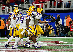LSU Tigers wide receiver Justin Jefferson (2) celebrates with his teammates after he scores during the first half against Oklahoma Sooners in the 2019 College Football Playoff Semifinal at the Chick-fil-A Peach Bowl on Saturday, Dec. 28, in Atlanta. (Paul Abell via Abell Images for the Chick-fil-A Peach Bowl)