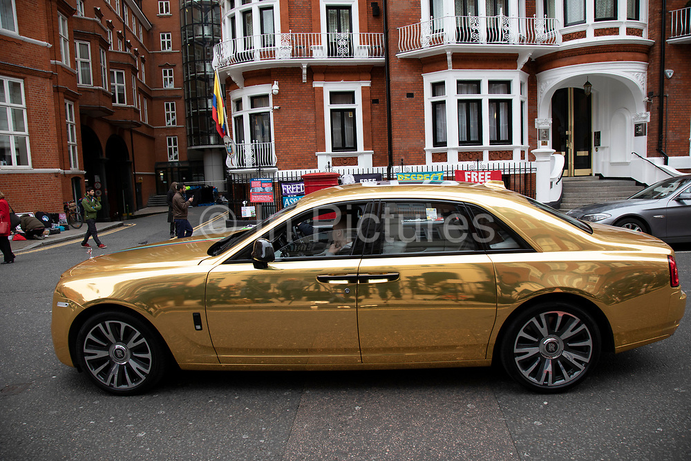 Gold Bentley in the wealthy area of Knightbridge in London, United Kingdom. This is an area where the rich in their supercars parade them around driving with little more reason than showing off their exclisive cars.