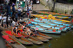 © Licensed to London News Pictures. 19/07/2016. Oxford, UK. A group of young women relax in the sunshine while waiting to be taken out on punts on the River Cherwell in the grounds of Oxford University in Oxfordshire. Today is due to be the hottest day of 2016 so far, with temperatures possibly hitting the mid 30's.  Photo credit: Ben Cawthra/LNP