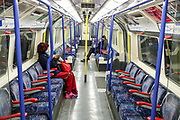 April 8, 2020, London, England, United Kingdom: People are seen wearing face protective masks on a London underground subway train, as the UK continues in lockdown to help curb the spread of the coronavirus. (Credit Image: © Vedat Xhymshiti/ZUMA Wire)