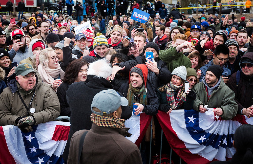 Supporters crowd around Democratic 2020 presidential candidate Bernie Sanders during a rally at James Madison Park in Madison, WI on Friday, April 12, 2019.