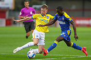Brighton and Hove Albion defender Sam Packham (59) tackles AFC Wimbledon defender Paul Osew (37) during the EFL Trophy Southern Group G match between AFC Wimbledon and Brighton and Hove Albion U21 at The People's Pension Stadium, Crawley, England on 22 September 2020.