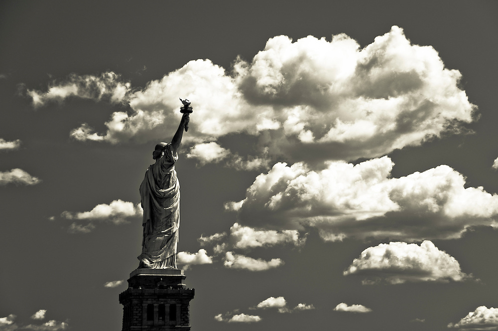 The Liberty Statue surrounded by clouds, New York.