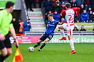 Tom Hamer of Oldham Athletic (34) clears under pressure from Kieran Sadlier of Doncaster Rovers (22) during the The FA Cup fourth round match between Doncaster Rovers and Oldham Athletic at the Keepmoat Stadium, Doncaster, England on 26 January 2019.