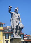 Sculptural street detail from Florence, Italy. A figurative sculpture representing Dionysus/Bacchus. The God of wine.