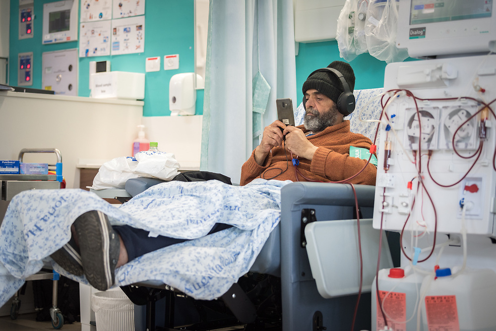 24 February 2020, Jerusalem: Yihya Jandoubi looks at his phone while receiving Dialysis treatment at the Augusta Victoria Hospital in Jerusalem.