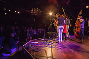 Kristin Andreassen and friends on the stage in front of a packed Bell House at the Brooklyn Folk Festival.