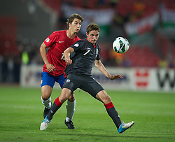 11.09.2012, Karadorde Stadion, Novi Sad, SRB, FIFA WM Qualifikation, Serbien vs Wales, im Bild Wales' Joe Allen in action against Serbia during FIFA World Cup Qualifier Match between Serbia and Wales at the Karadorde Stadium, Novi Sad, Serbia on 2012/09/11. EXPA Pictures © 2012, PhotoCredit: EXPA/ Propagandaphoto/ David Rawcliff..***** ATTENTION - OUT OF ENG, GBR, UK *****