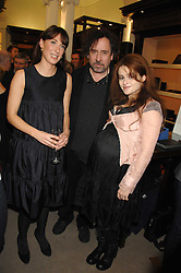 Left to right, SAMANTHA CAMERON, TIM BURTON and HELENA BONHAM-CARTER at a party to celebrate the launch of the book 'Long Way Down' by Ewan McGregor and Charley Boorman held at Smythson, 40 New Bond Street, London W1 on 19th November 2007,<br /><br />NON EXCLUSIVE - WORLD RIGHTS