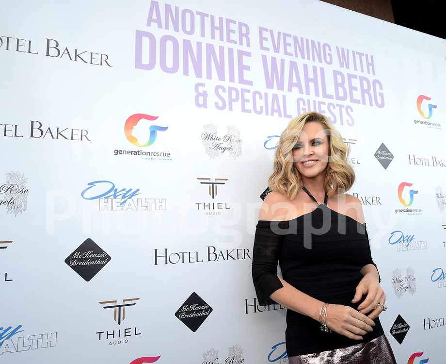 Jenny McCarthy poses on the red carpet for fan and media before her husband Donnie Wahlberg performs a concert in St. Charles at the to Arcada Theatre raise money and awareness for Generation Rescue on June 19, 2017.