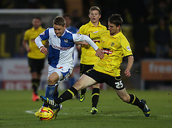 Bristol Rovers' Eliot Richards is tackled by Burton Albion's Shane Cansdell-Sherriff- Photo mandatory by-line: Matt Bunn/JMP - Tel: Mobile: 07966 386802 23/11/2013 - SPORT - Football - Burton - Pirelli Stadium - Burton Albion v Bristol Rovers - Sky Bet League Two