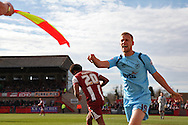 Jayden Stockley of Torquay appeals to the referee's assistant. Skybet football league two match, Cheltenham Town v Torquay Utd at the Abbey Business stadium, Whaddon Rd in Cheltenham on Saturday 15th March 2014.<br /> pic by Mark Hawkins, Andrew Orchard sports photography.
