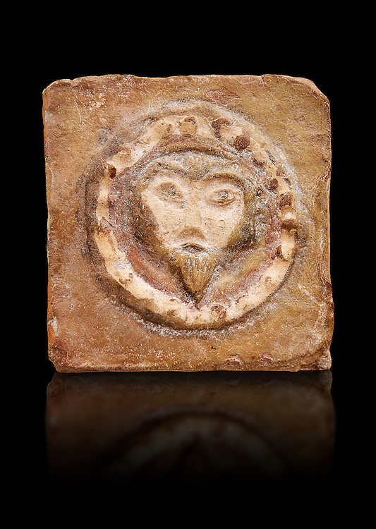 6th-7th Century Eastern Roman Byzantine  Christian Terracotta tiles depicting Christ - Produced in Byzacena -  present day Tunisia. <br /> <br /> These early Christian terracotta tiles were mass produced thanks to moulds. Their quadrangular, square or rectangular shape as well as the standardised sizes in use in the different regions were determined by their architectonic function and were designed to facilitate their assembly according to various combinations to decorate large flat surfaces of walls or ceilings. <br /> <br /> Byzacena stood out for its use of biblical and hagiographic themes and a richer variety of animals, birds and roses. Some deer and lions were obviously inspired from Zeugitana prototypes attesting to the pre-existence of this province's production with respect to that of Byzacena. The rules governing this art are similar to those that applied to late Roman and Christian art with, in the case of Byzacena, an obvious popular connotation. Its distinguishing features are flatness, a predilection for symmetrical compositions, frontal and lateral representations, the absence of tridimensional attitudes and the naivety of some details (large eyes, pointed chins). Mass production enabled this type of decoration to be widely used at little cost and it played a role as ideograms and for teaching catechism through pictures. Painting, now often faded, enhanced motifs in relief or enriched them with additional details to break their repetitive monotony.<br /> <br /> The Bardo National Museum Tunis, Tunisia.  Against a black background.