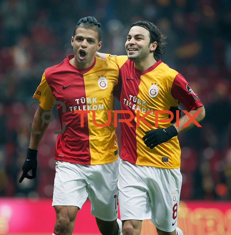 Galatasaray's Felipe Melo (L) celebrate his goal with team mate during their Turkish Super League soccer match Galatasaray between Kardemir Karabukspor at the Turk Telekom Arena at Seyrantepe in Istanbul Turkey on Saturday 14 January 2012. Photo by TURKPIX