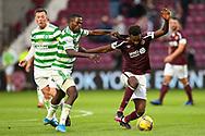 Ismaila Soro (#19) of Celtic FC pulls back Beni Baningime (#6) of Heart of Midlothian FC during the Cinch SPFL Premiership match between Heart of Midlothian FC and Celtic FC at Tynecastle Park, Edinburgh, Scotland on 31 July 2021.