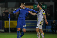 AFC Wimbledon striker Joe Pigott (39) trying to celebrate AFC Wimbledon midfielder Callum Reilly (33) goal but has shirt pulled by Burton Albion midfielder John-Joe O'Toole (21) during the EFL Sky Bet League 1 match between AFC Wimbledon and Burton Albion at the Cherry Red Records Stadium, Kingston, England on 28 January 2020.