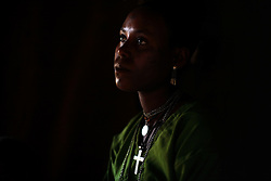 Leyualem Mucha, 14, has a moment alone before being wisked away on a mule by her new groom and groomsmen in the Amhara Region, Ethiopia on May 23, 2007.  Leyualem had never met her husband before her wedding day, yet sumitted as they bound her in the white wedding cloth. The men later said it was placed over her head so she would not be able to find her way back home, should she want to escape the marriage.