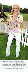 NORMANDIE KEITH with her dogs Sugar & Lotti at a dog show in London on 6th July 2004.PWY 25