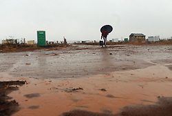 South African - Johannesburg - 16 June 2020 - A local resident in Lawley informal settlement is seen making his way to collect water, in the cold and rainy weather. <br />Picture: Itumeleng English/Africa News Agency(ANA)