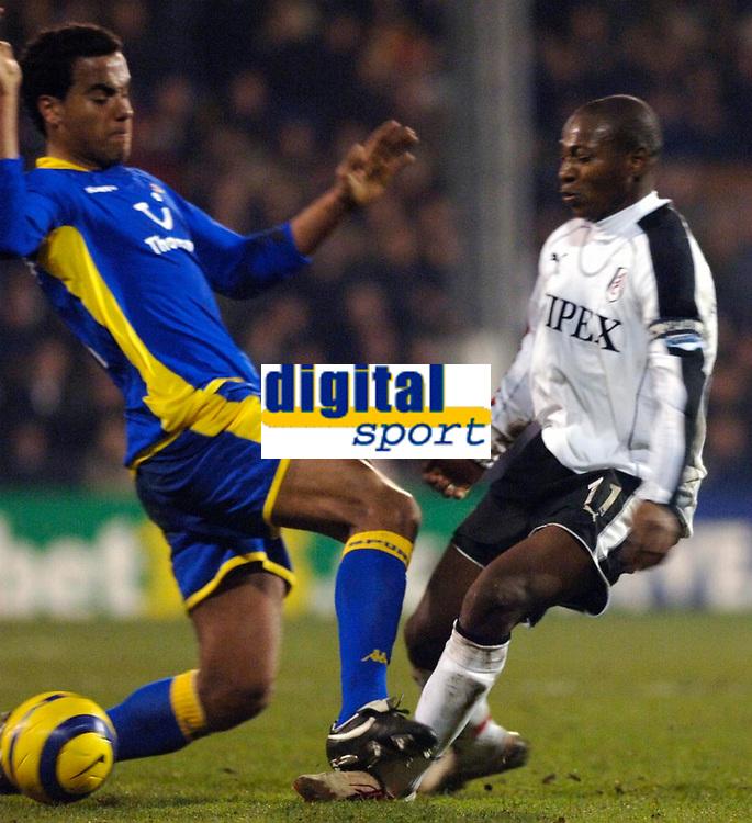 Photo: Daniel Hambury.<br />Fulham v Tottenham Hotspurs. Barclays Premiership. 31/01/2006.<br />Fulham's Luis Boa Morte receives a tackle 'over the top' from Tottenham's Tom Huddlestone.