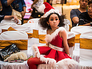 17 SEPTEMBER 2015 - BANGKOK, THAILAND:  A participant in the Santa pageant waits for the pageant to start at the World Santa Claus Congress. Twenty-six Santa Clauses from around the world are in Bangkok for the first World Santa Claus Congress. The World Santa Claus Congress has been an annual event in Denmark since 1957. This year's event, hosted by Snow Town, a theme park with a winter and snow theme, hosted the event. There were Santas from Japan, Hong Kong, the US, Canada, Germany, France and Denmark. They presented gifts to Thai children and judged a Santa pageant. Thailand, a Buddhist country, does not celebrate the religious aspects of Christmas, but Thais do celebrate the commercial aspects of the holiday.   PHOTO BY JACK KURTZ