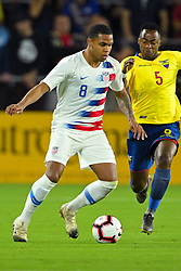 March 21, 2019 - Orlando, Florida, USA - US midfielder Weston McKennie (8)  and Ecuador midfielder Renato Ibarra (5) go for a ball during an international friendly between the US and Ecuador at Orlando City Stadium on March 21, 2019 in Orlando, Florida. .The US won the game 1-0...©2019 Scott A. Miller. (Credit Image: © Scott A. Miller/ZUMA Wire)