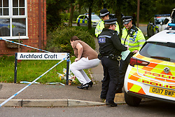 © Licensed to London News Pictures. 20/10/2019. Milton Keynes, UK. A woman leaves flowers near the scene in Archford Croft in Emerson Valley where two 17 year old boys were stabbed to death overnight. Two adult males where also injured. Thames Valley Police have begun a double murder investigation but have yet to make any arrests.  Photo credit: Cliff Hide/LNP