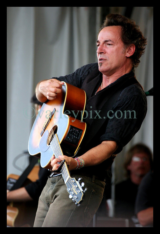 April 30th, 2006. New Orleans, Louisiana. Jazzfest . The New Orleans Jazz and Heritage festival. Music legend Bruce Springsteen plays with the Seeger Sessions band on the Acura Stage.