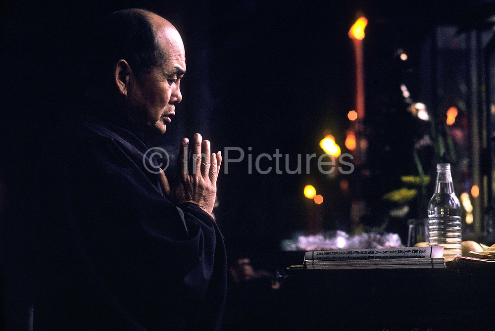 Buddhist priest in Lung Shang Temple, Taipei, Taiwan