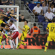 Goalkeeper Luis Robles, New York Red Bulls, punches clear during the New York Red Bulls Vs Columbus Crew, Major League Soccer regular season match at Red Bull Arena, Harrison, New Jersey. USA. 12th July 2014. Photo Tim Clayton