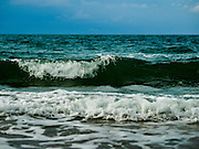 17 JANUARY 2016 - KLEANG, RAYONG, THAILAND:  The morning surf at Laem Mae Phim Beach and the Princess Beach Resort and Spa on the Gulf of Siam in Rayong province of Thailand.           PHOTO BY JACK KURTZ
