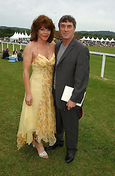 Actor BILLLY MURRAY and his wife ELAINE MURRAY at the Kuoni World Class Polo Day held at Hurtwood Park Polo Club, Surrey on 29th May 2005.<br />
