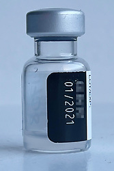 © Licensed to London News Pictures. 05/01/2021. A vial of Pfizer COVID-19 vaccine, still containing an amount of vaccine, which was discarded after being administered to frontline NHS staff in Cornwall. The vials are intended to provide five doses of vaccine. The Israeli government authorised the use of six doses per bottle, which has increased the county's vaccine supply. Photo credit: LNP