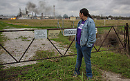 Cherri Foytlin  at the site where the explosion of a Phillips 66 pipeline took place in Paradis, LA on Feb 9h. Two days later the fire is still burring though it has gone down considerably. One worker is still missing, presumed dead.