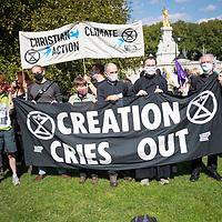 An ecumenical group from Christian Climate Action carries a banner at the beginning of a march urging government to take urgent action on climate change. The group includes Rev. Hilary Bond, former Archbishop Right Rev. Dr Rowan Williams. Members of the group were arrested later during the demonstration., Fr Martin Newell, Rev Jonathan Herbert