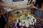 SHANGHAI, CHINA - AUGUST 29: (CHINA OUT) <br /> <br /> Host and workers close the deceased dog\'s coffin during it\'s funeral bought online with 8,000 RMB on August 29, 2015 in Shanghai, China. Miss Wang spent more than 8,000 RMB (about 1,252.8 USD) to buy her deceased dog a funeral on Taobao.com which is China\'s biggest online shop. The dog\'s funeral includes memorial service, cremation and religious rite. The host of the online funeral shop said that they received orders of animal funerals almost everyday. <br /> ©Exclusivepix Media