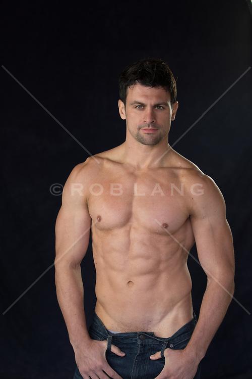 shirtless muscular man with green eyes and dark hair